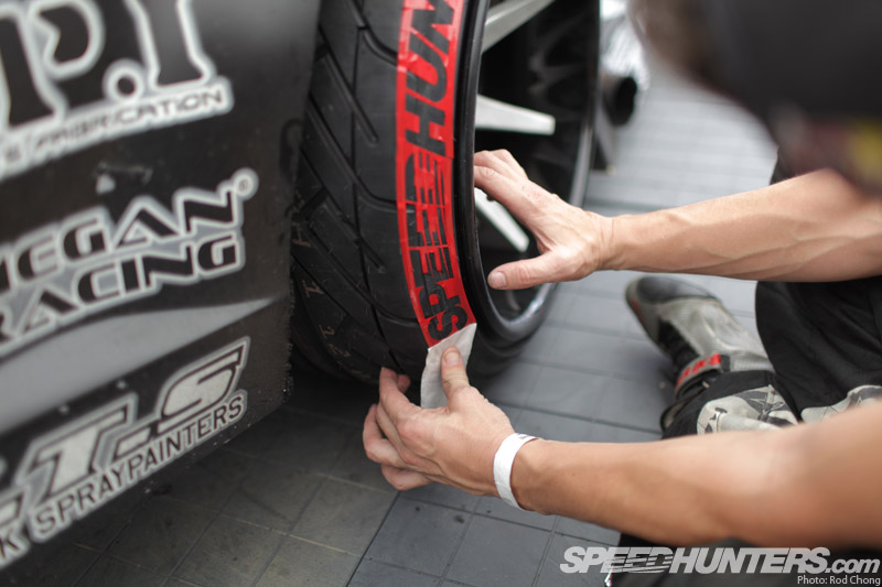Now peel the application paper off back hard on itself to leave only the stencil mask on your tire be sure to take care with the sharp edges as they may